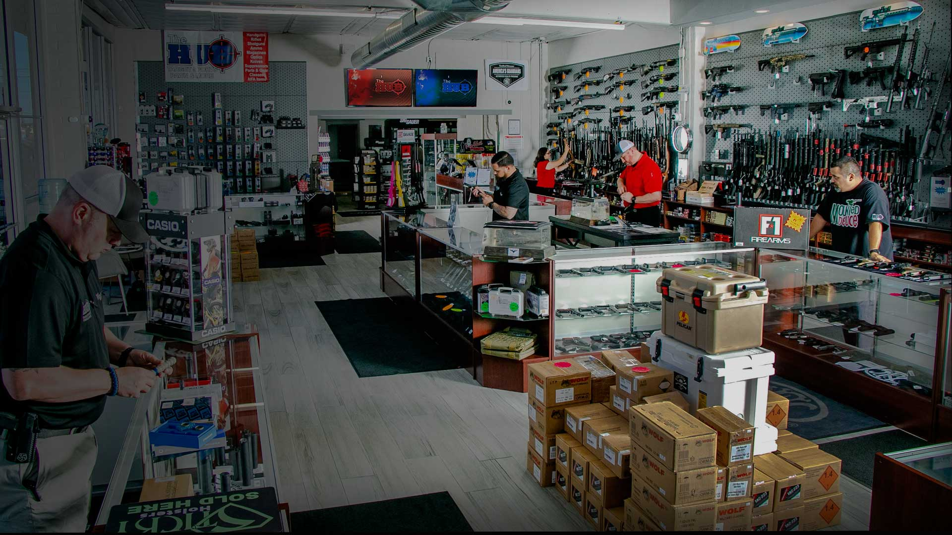 Our gun store's friendly and helpful associates assisting customers